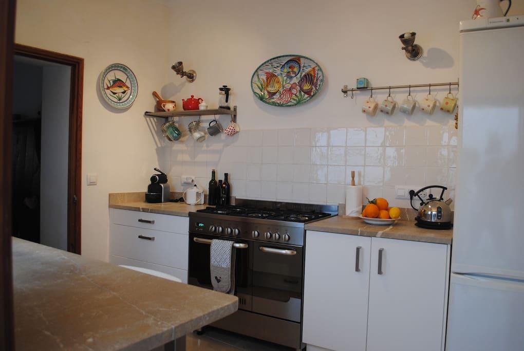 well equiped kitchen with fridge/freezer, dishwasher, large oven and huge larder