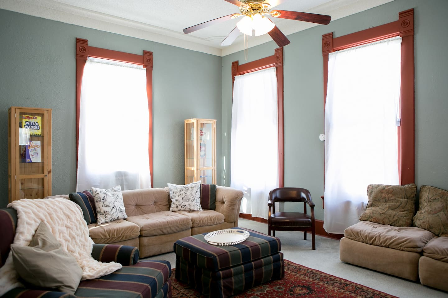 Sunlight streams into the windows in the spacious living room. Ample seating is provided for you and your guests!