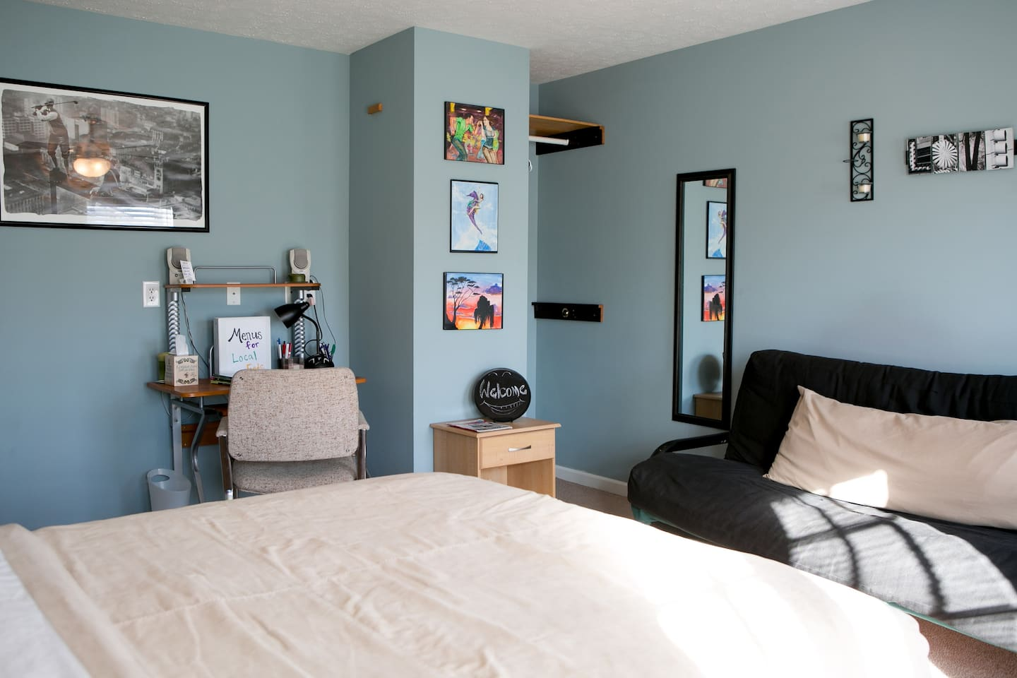 Master bedroom.  Queen size bed, futon, small space to hang clothes, and desk for working/studying.