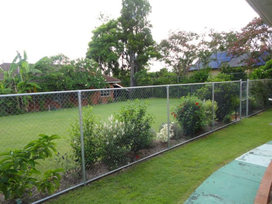 Views from most windows to the grassed tennis court area outside the door