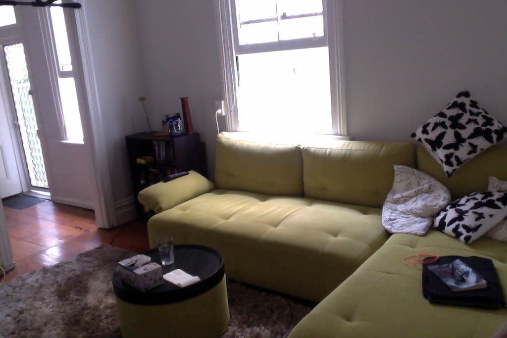 Living Room - L couch, large TV with Chromecast.