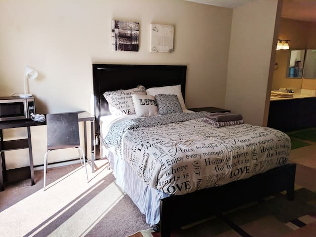Spacious master bedroom & yard w/ private entrance