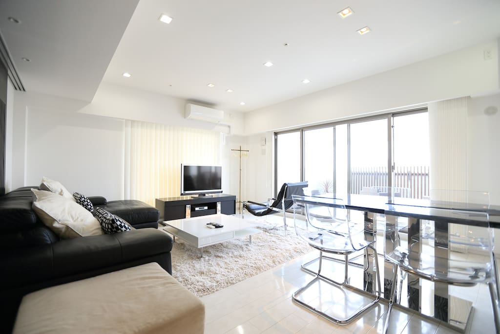 The living area with large comfortable sofa plus dinning table for 6