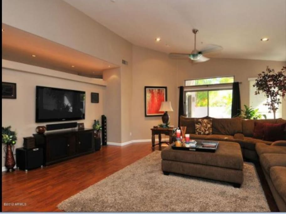 Shared great room area with gorgeous hardwood