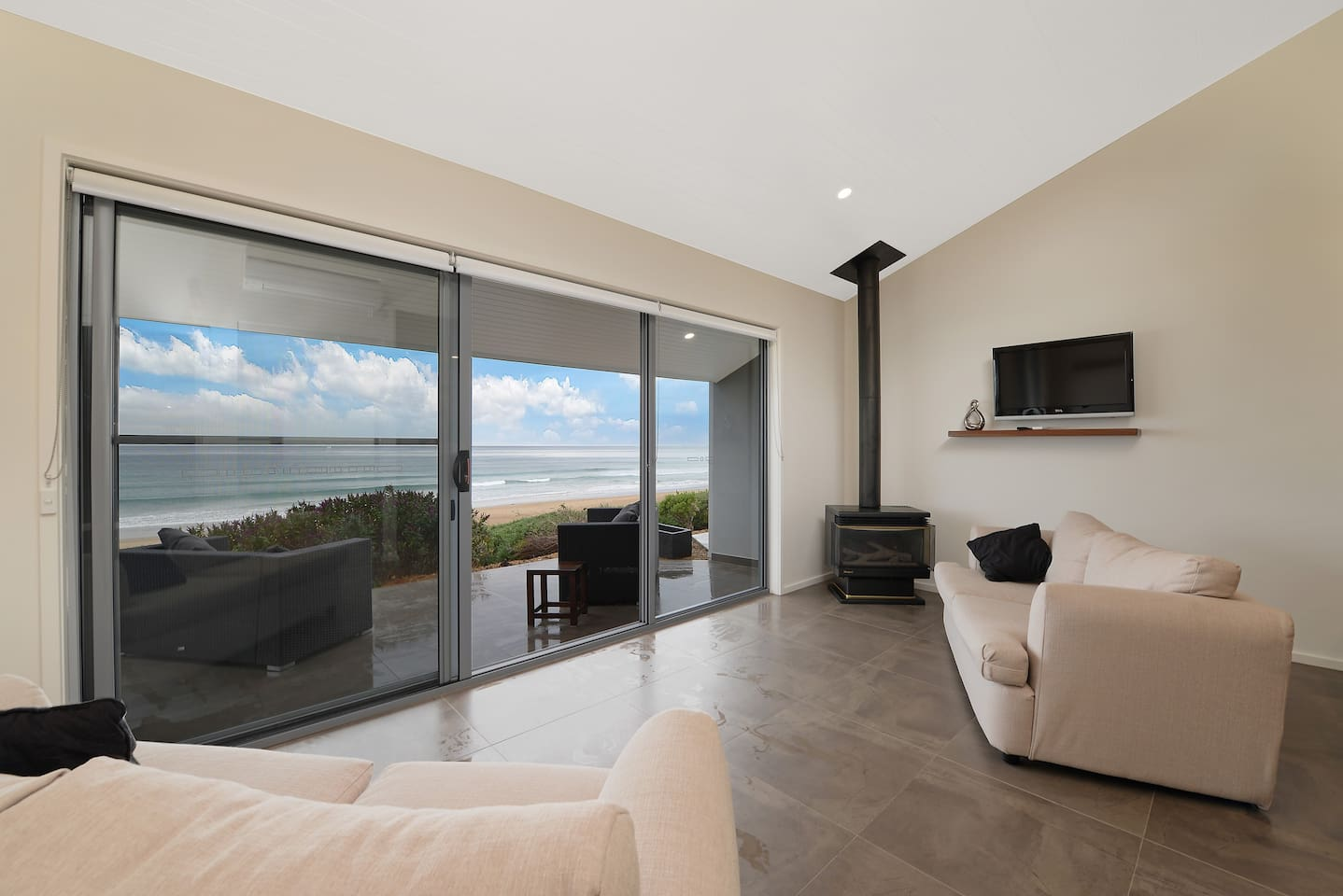 Beach view from bed and lounge area. gas fire for the winter nights