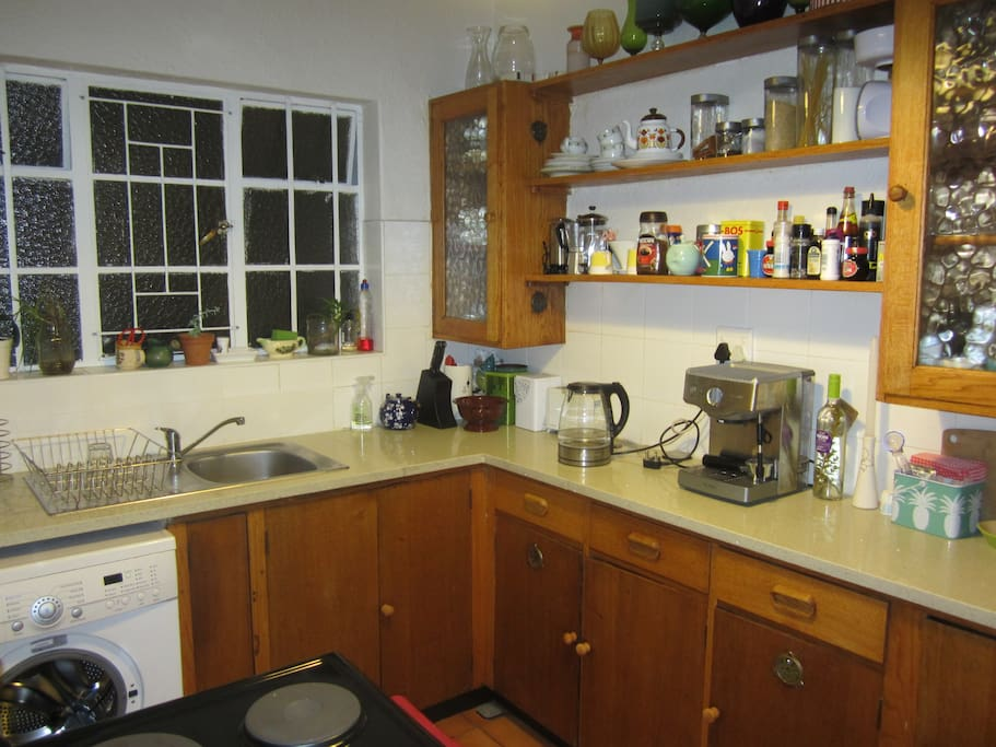 Kitchen with fridge, washing machine, microwave, stove etc.
