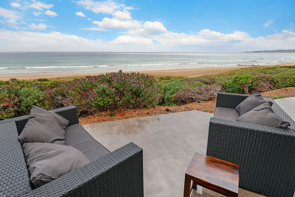 Relax on the patio, and watch for dolphins and whales, 40m across to the sand