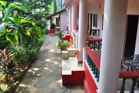 Omkar guest House Mango tree view room AC room 1