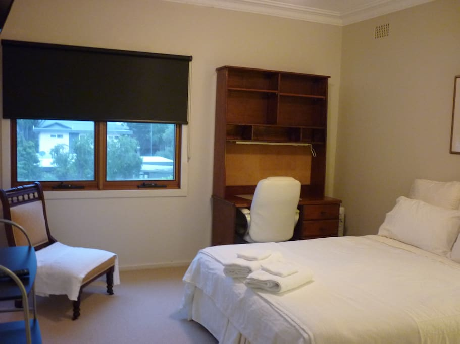 Room 1:  Queen room with TV/DVD, desk & chair, ceiling fan, grandmother chair and BIR.