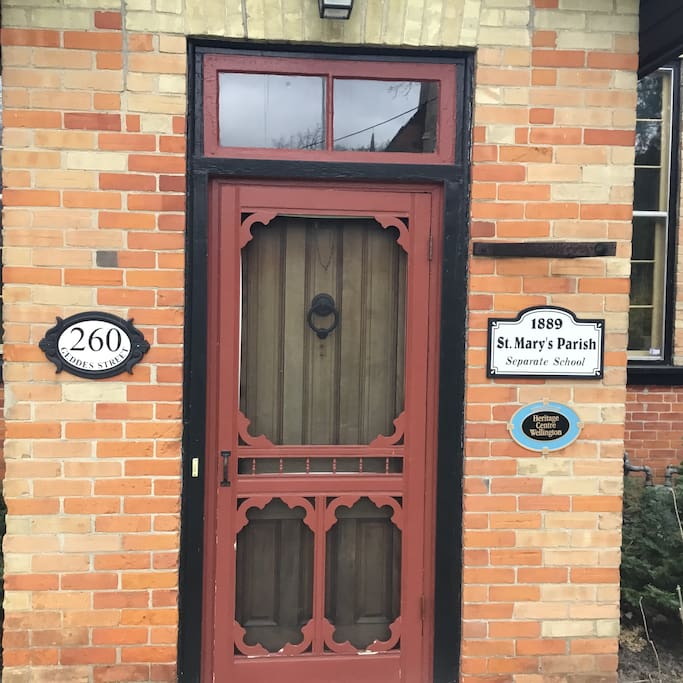 This entrance notes the heritage designation of the 1889 schoolhouse