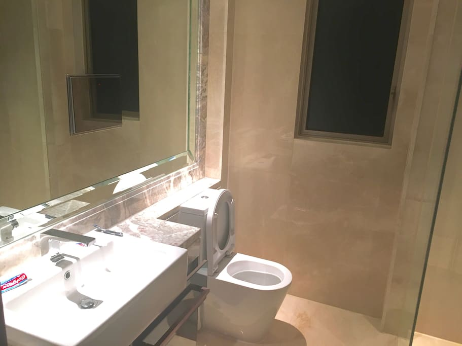 Bathroom with LED TV in mirror.