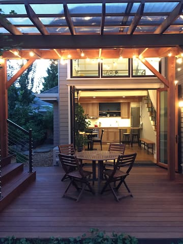 Evening glow. Triple folding glass doors open up to our  backyard deck (an area shared between our family and yours).