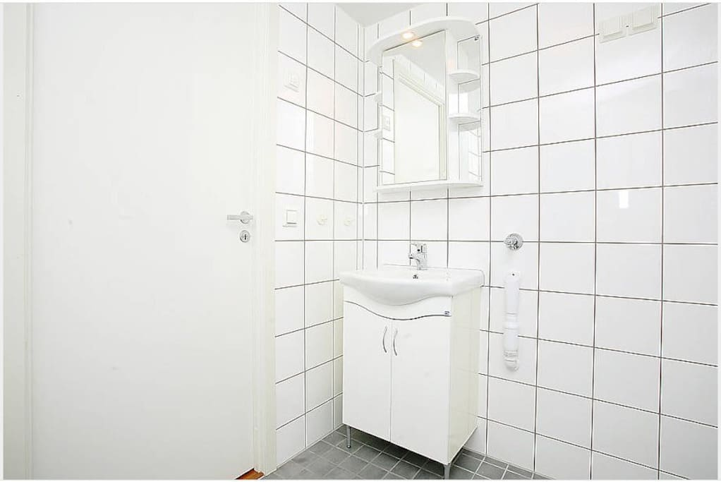 Bathroom, sink, also a combined washer/dryer in here!