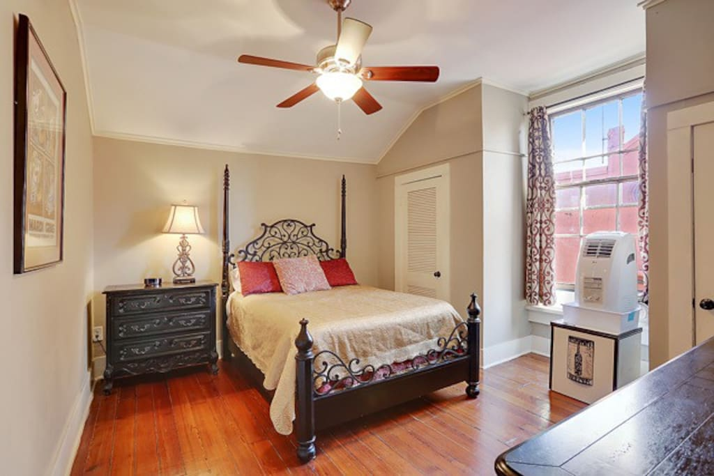 First of two large bedrooms has a queen sized bed and ample closet space.