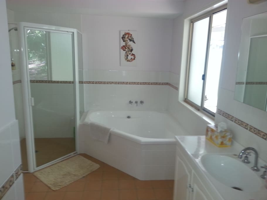 Large private bathroom with separate shower, bath and toilet