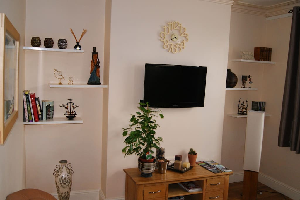 Living Room. TV has freeview and there is a range of novels and guide books for you to read.