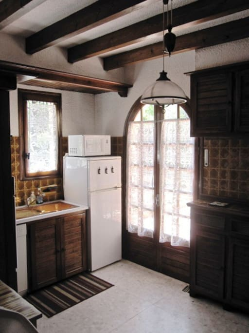 Kitchen with propane stove, electric oven and all the cooking utensils.