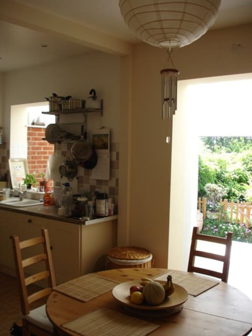 Kitchen and dining room with a view over conservatory.