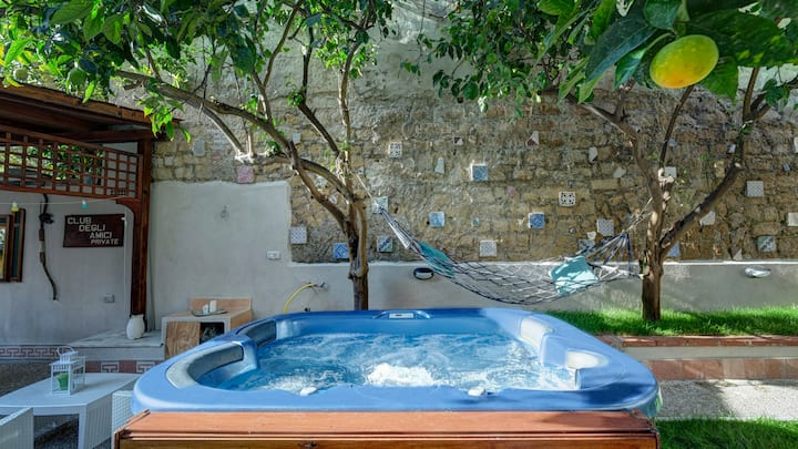 blu house with garden and Jacuzzi in the center