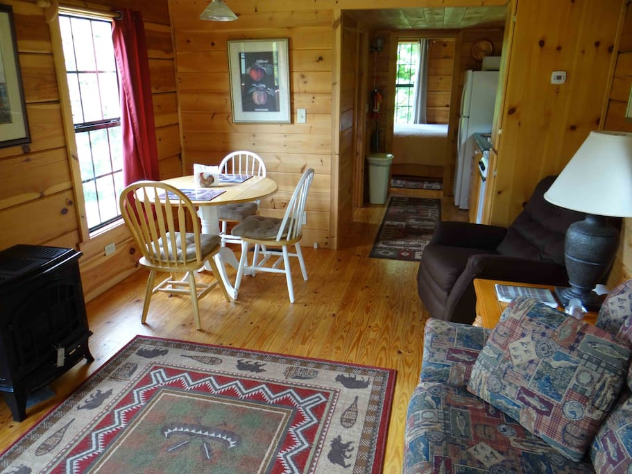 This is the living room and dining area of the Looking Glass Mountain cabin.