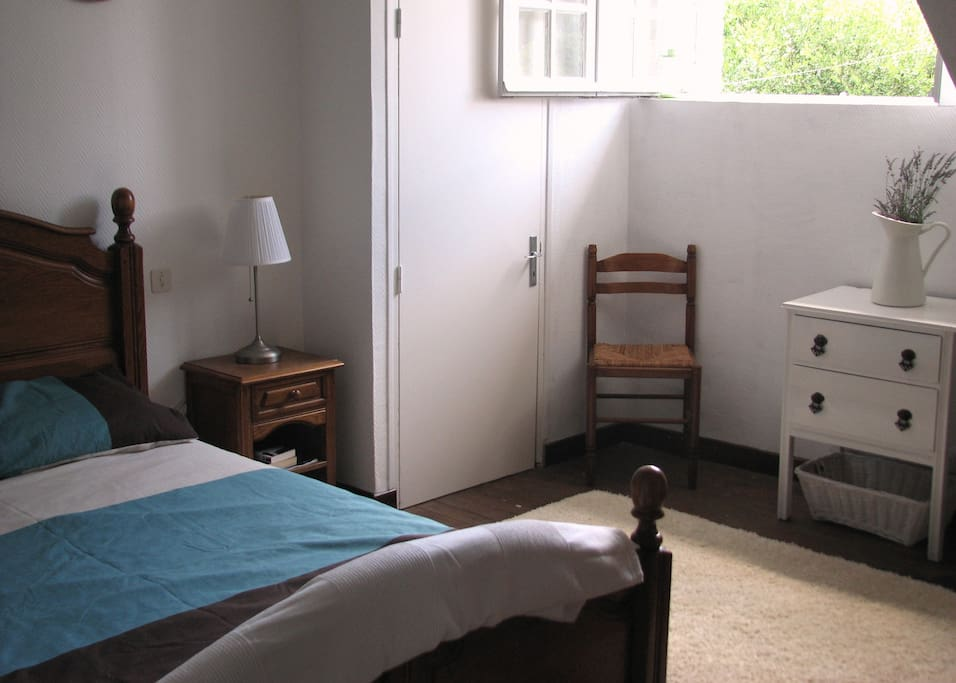Double bedroom with large wardrobe and cupboards