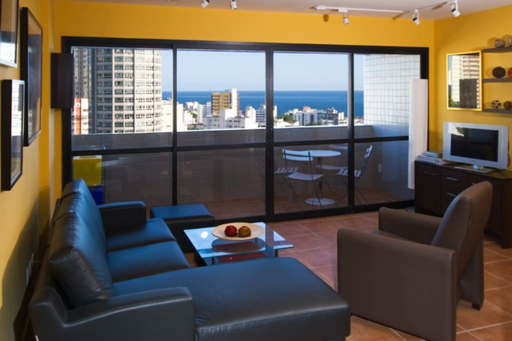 Living room, balcony with ocean view.