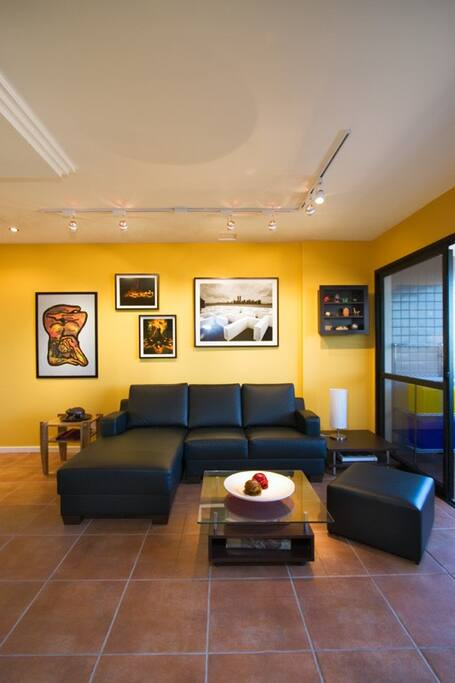 Living room from another angle, highlighting artwork & decoration