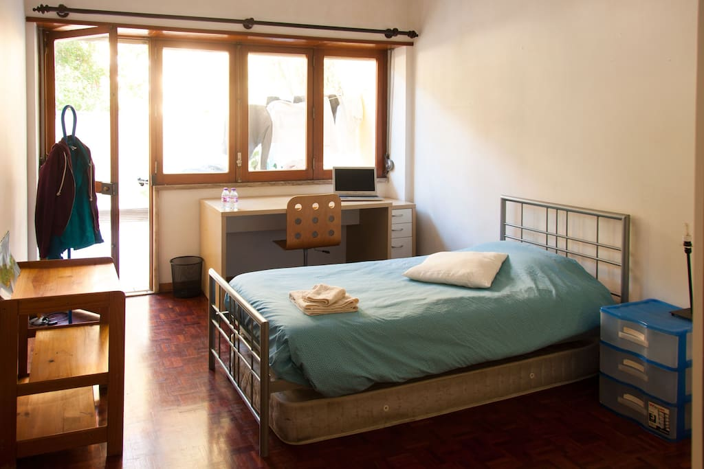 There's a single but big bed and an extra mattress. The room is very big and there's enough space for two people! A big window door is the access to the terrace