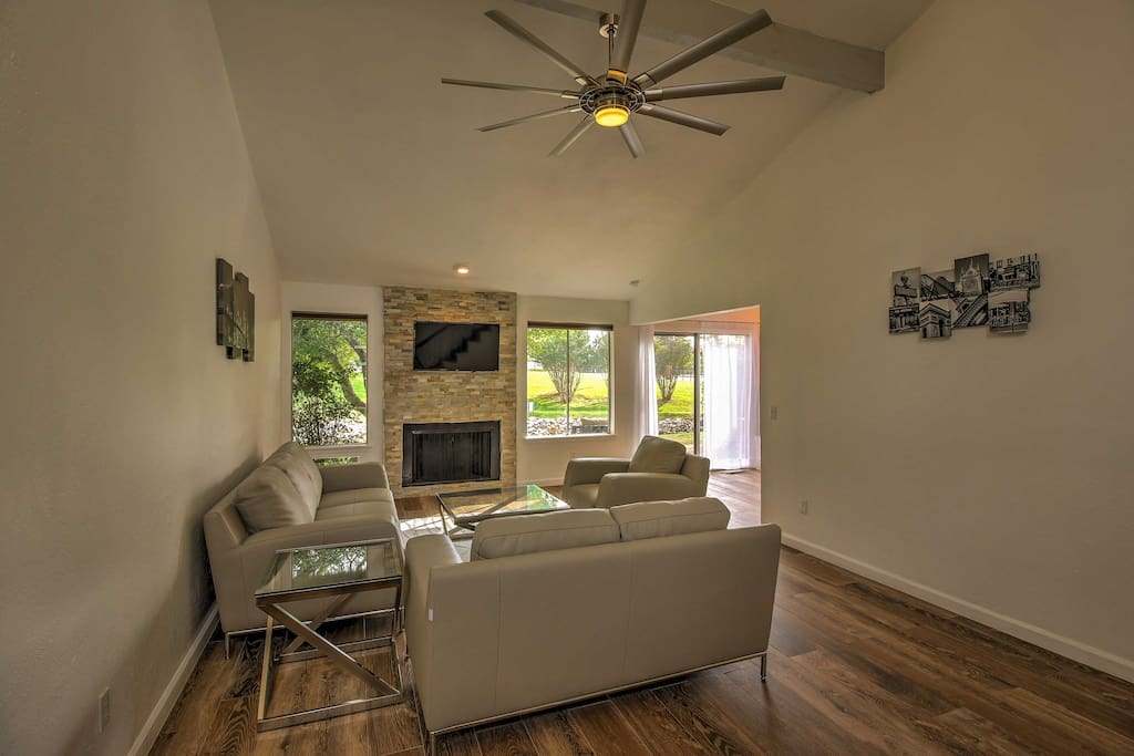 An open floor plan and tall ceilings create a spacious feel throughout.