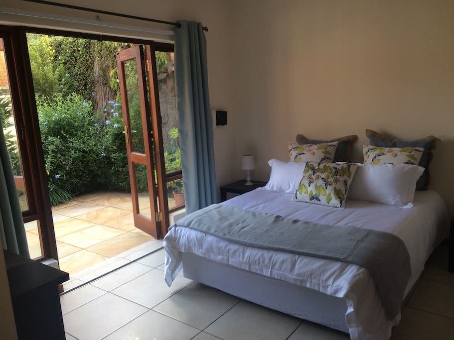 tranquil, private bedroom opens onto lush garden