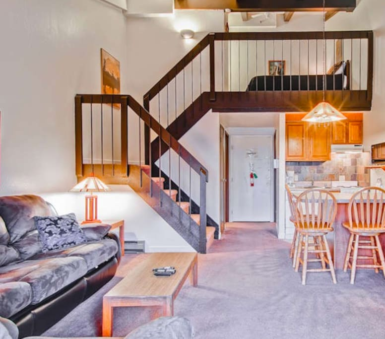 Two story Loft Condo, with a king bed in the loft, and a sofa sleeper in the living room area.