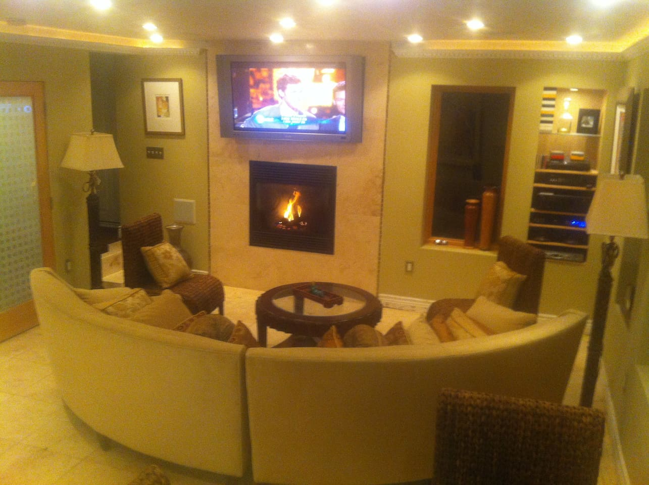 Circular sectional with remote-controlled fireplace