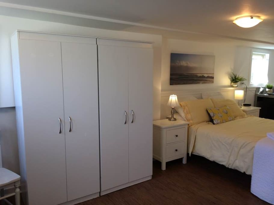 good sized bedroom with queen bed, ensuite washroom and good closet space