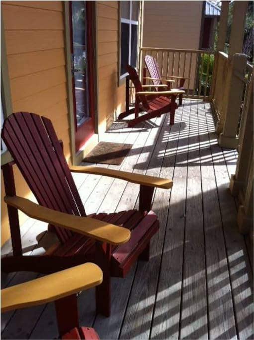 Enjoy the Front Porch While Seated in the Adirondack Chairs