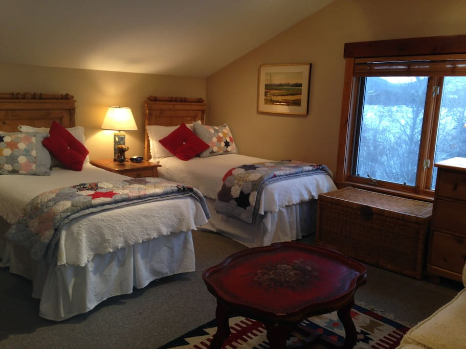 second bedroom with twin beds and antique pine furniture and adjacent sitting area on 2nd floor.