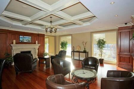 Bedroom in luxury Uptown Condo