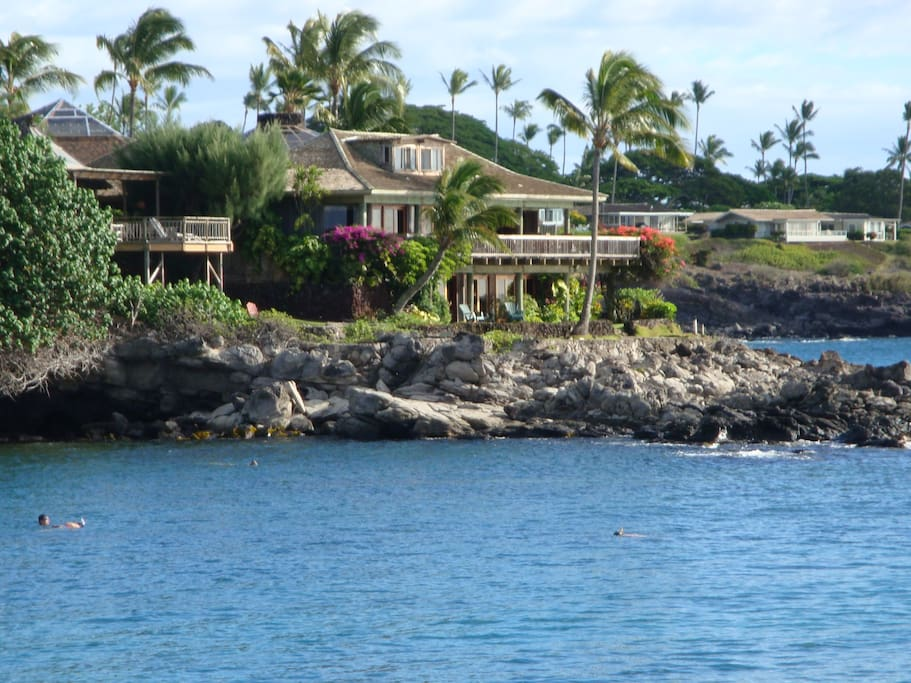 Incredible view of the home from the water! You can see the snorkelers out front.