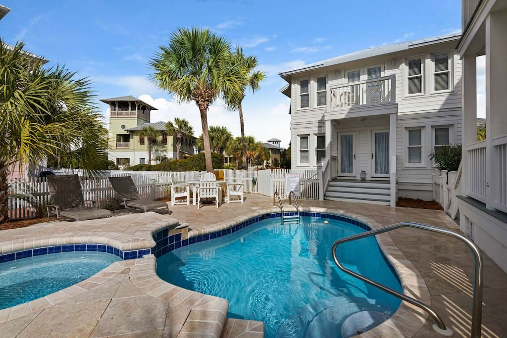 """Relax by this peaceful pool shared with the sister property """"Love Shack"""" (pictured here)"""