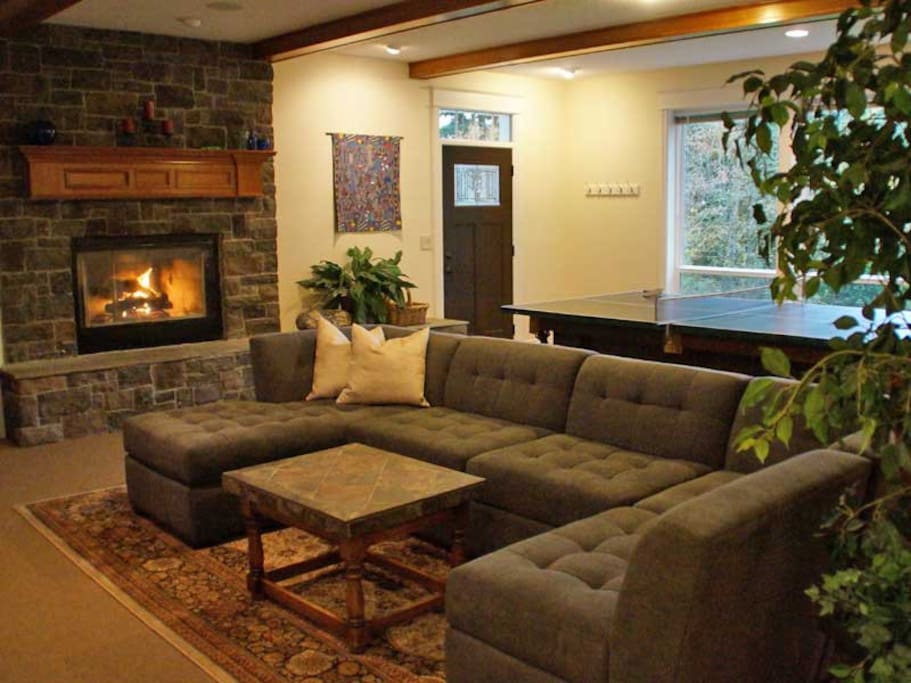 Living room is a great place to leisure or play games.  The sectional couch gets a lot of compliments from our guests!