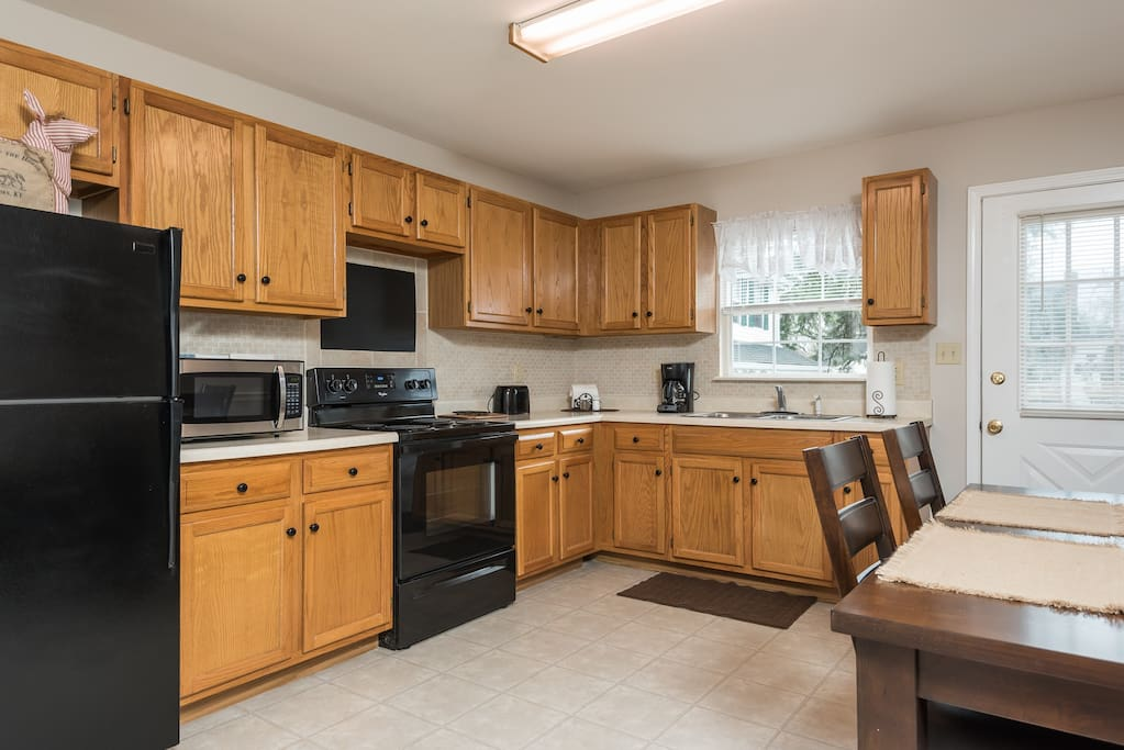 Spacious kitchen with full size refrigerator, stove and all you need to cook.