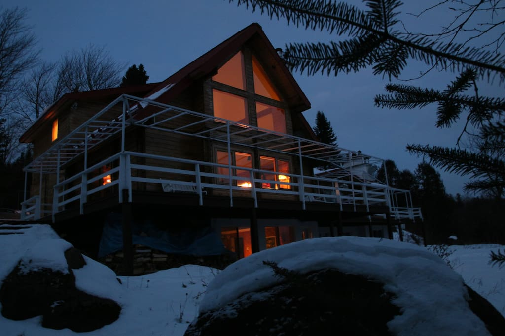 View of cottage overlooking Mountain Range,  balcony runs along the entire front of cottage.