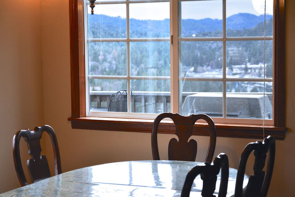 Dining room table area also includes a scenic view