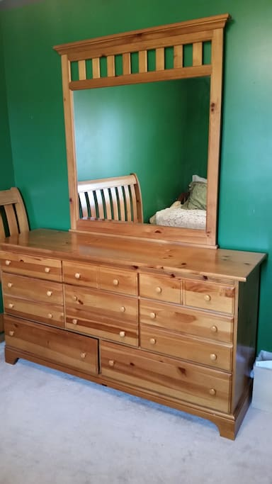 Large dresser and mirror for your use. Can bring a chair in if you want to use it as a desk.