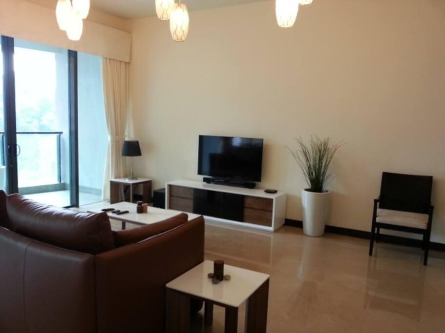 Living Room with flatscreen TV and Bluetooth Soundbar