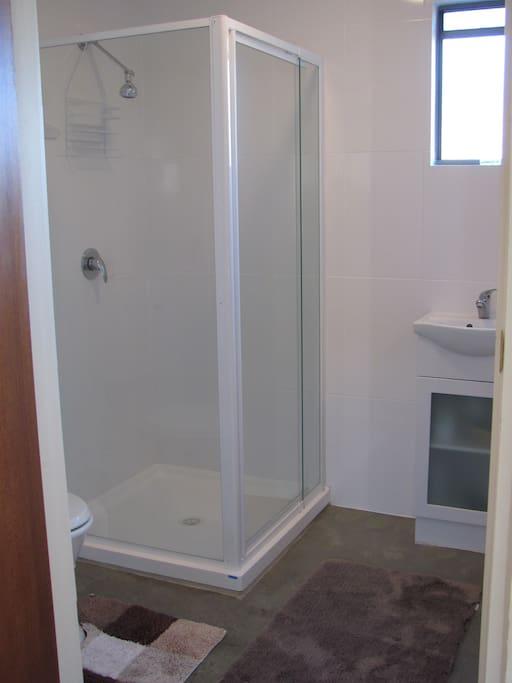 Bathroom, with toilet, shower, wash basin and heated towel rail