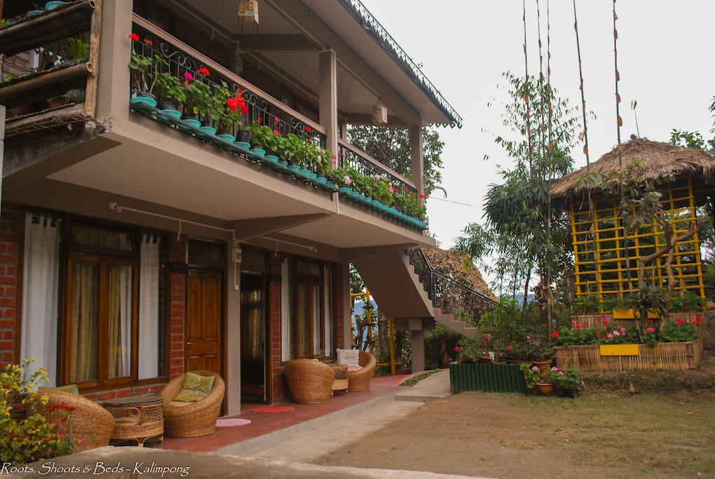 Mrs. Prateema Gurung (the mother of the house) loves her flowers. A bundle of creativity, she leaves no stone un-turned to get the best look and feel for a place. This is the front view of the lower deck rooms which faces the green lawn in-front.