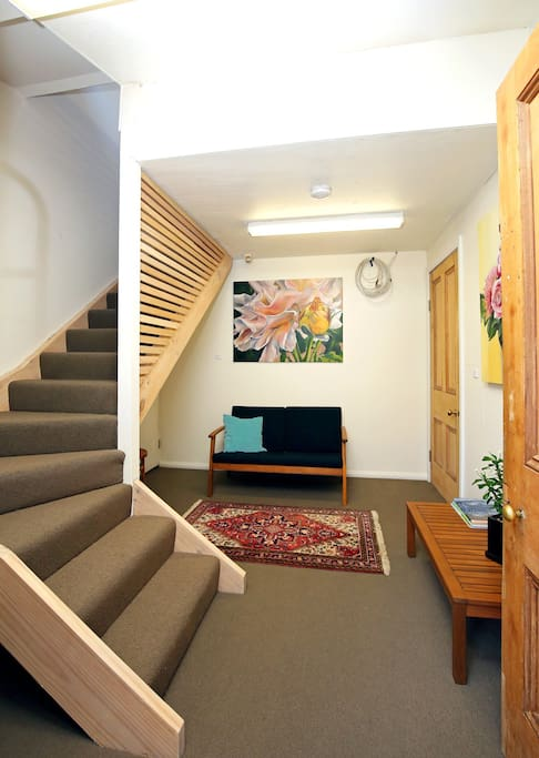 Downstairs entry with stairs to the  studio above