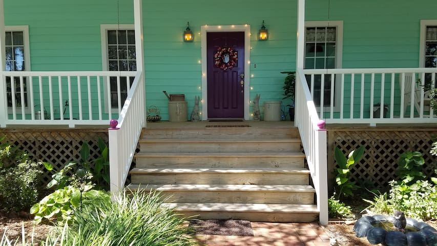 Six steps lead to front door. String lights around door are on all night for safety