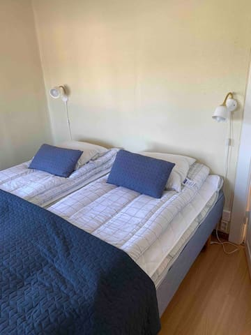 Bedroom entrance floor with a double bed.