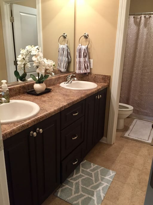 Private, double sink bathroom.